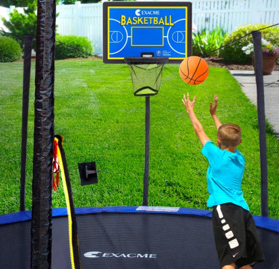 A child shooting a basketball into an Exacme basketball hoop