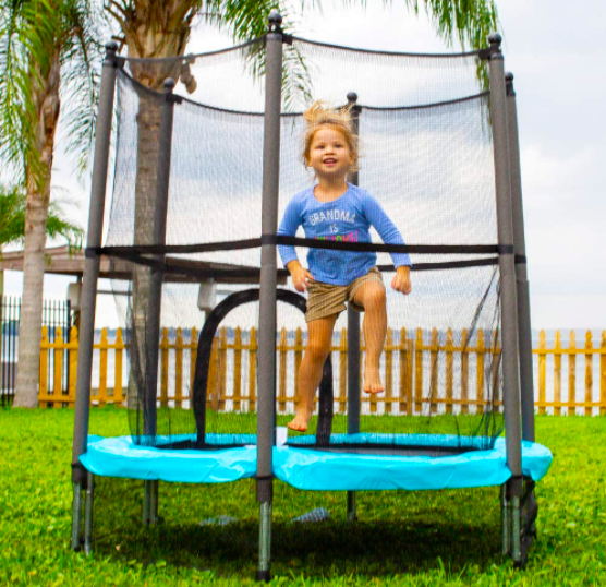 Young toddler bounces in this trampoline made specifically for kids.