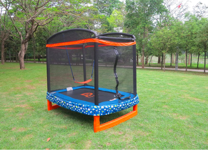 Jump Power Rectangle Trampoline in a yard. Large size toddler trampoline makes an excellent toy for multiple children.