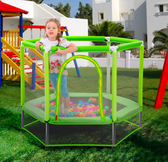 The Merax Trampoline filled with ball pit balls and a little girl playing. This is a great option for a young toddler.