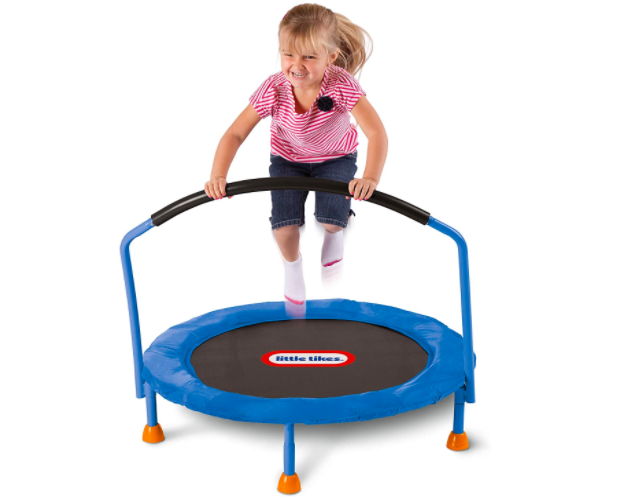 Little girl jumping on Little Tikes 3' Classic Trampoline, perfect for a toddler.