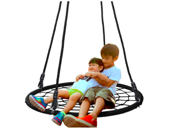 Two children swinging on their new toy.