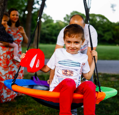 Children and adults can enjoy the Hazli Saucer Tree Swing