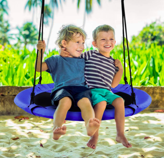 The Costzon Tree Swing being used by two young boys.