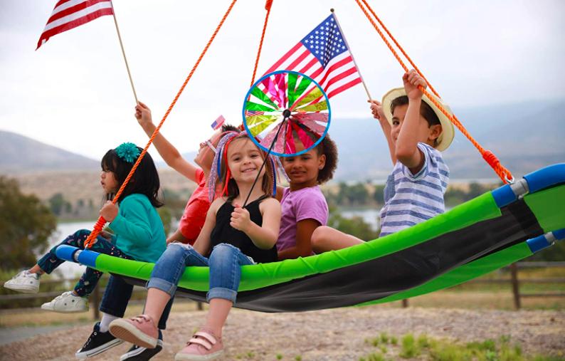 Many children riding on the SlideWhizzer Platform Swing