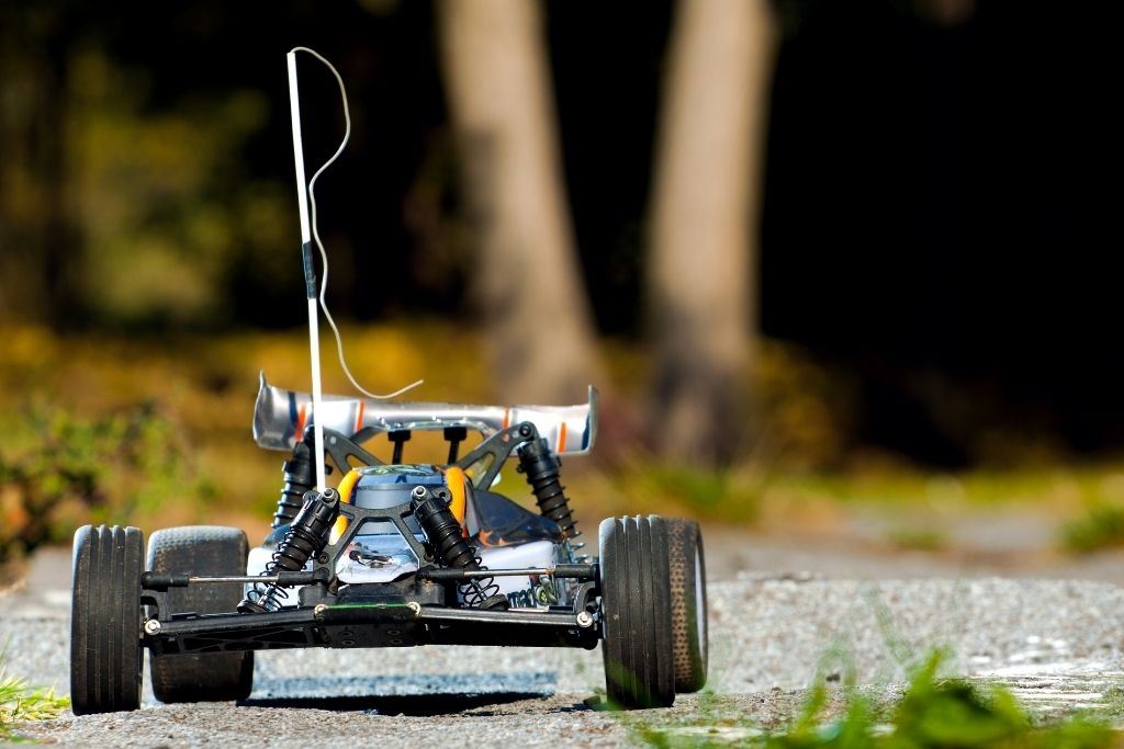 Remote control cars race in the backyard.