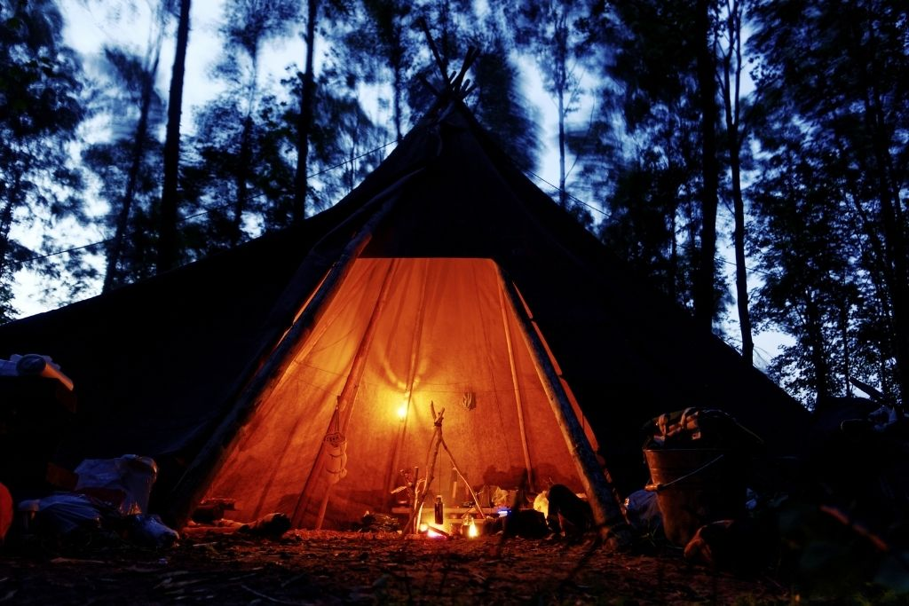 Similar to camping, setting up a tipi is such a fun backyard idea for kids. They will love spending time in their fort.