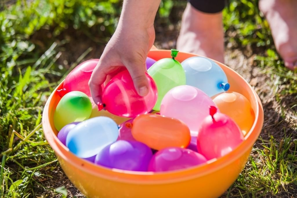 A bucket full of water balloons.