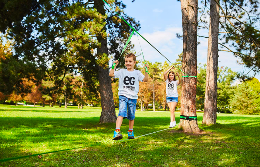 Two kids playing on the Exposed Gear Slackline Kit