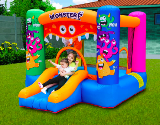 Monster style toddler bounce house with two young girls playing.