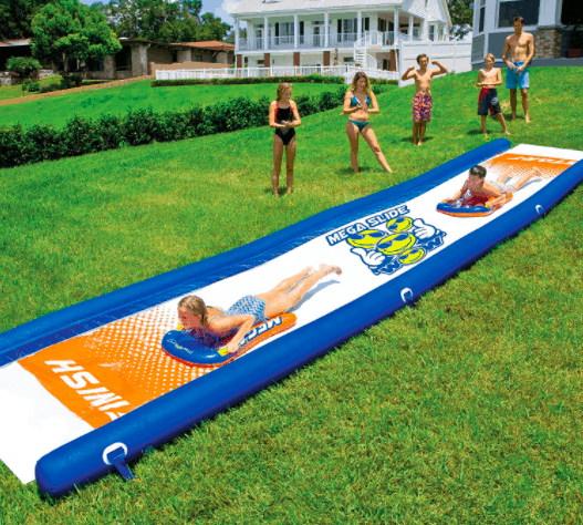 Kids Playing With Wow World of Watersports Slip and Slide