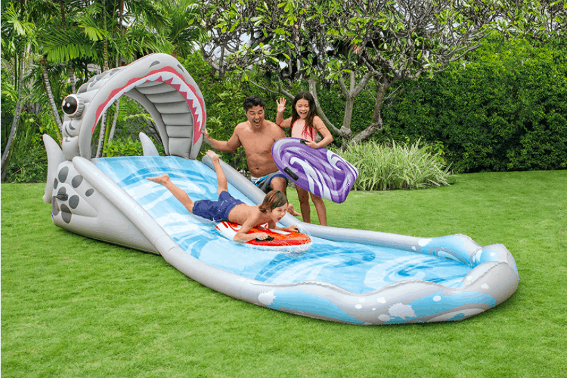 Children and Adults Playing With The Intex Slip And Slide