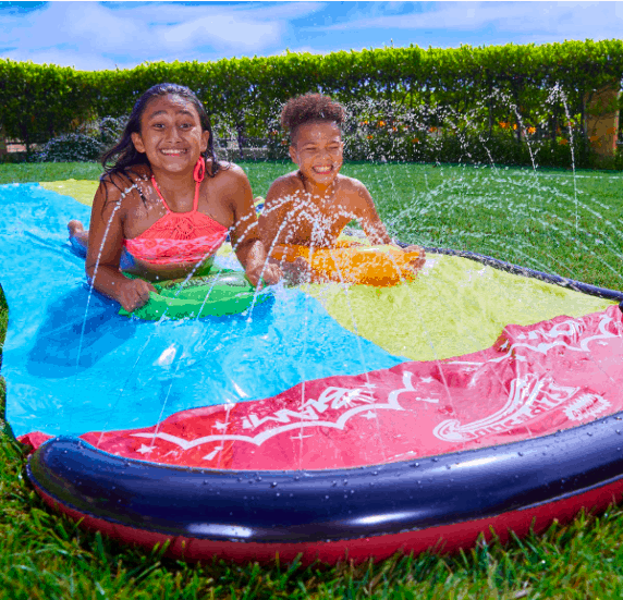 Wham-O Wave Rider With Two Children Sliding Down On Sleds