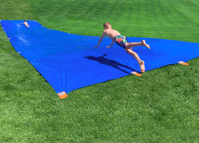 Sea Cow Slip And Slide With Child Diving Head First Down The Hill