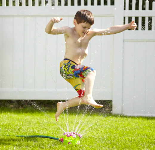 Melissa & Doug Pretty Petals Sprinkler With Young Boy Leaping