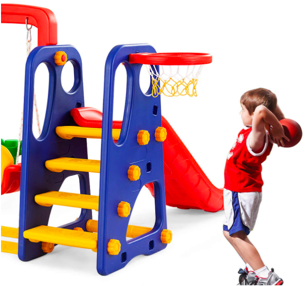 Little Boy Playing Basketball Attached To A Toddler Swing Set.