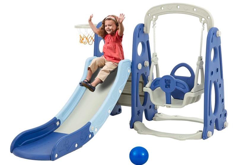 Young Girl Sliding Down A Slide On The Albott Toddler Slide and Swing Set