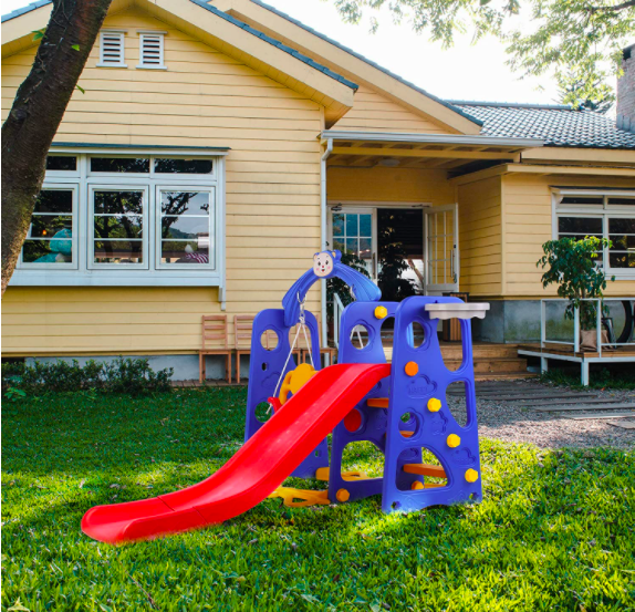 LAZY BUDDY 4 in 1 Kids Slide Swing Set In Front Of Yellow House