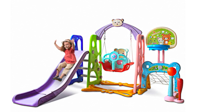 A Young Child Sliding Down A Slide On The Nzevz 6-In-1 Slide and Swing Set for Toddlers