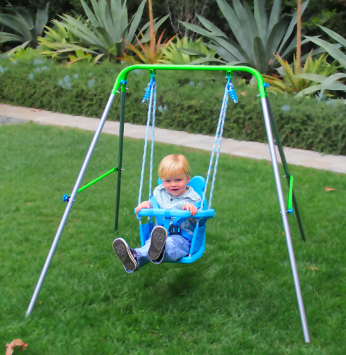 Young Toddler Swinging On The Sportspower My First Toddler Swing
