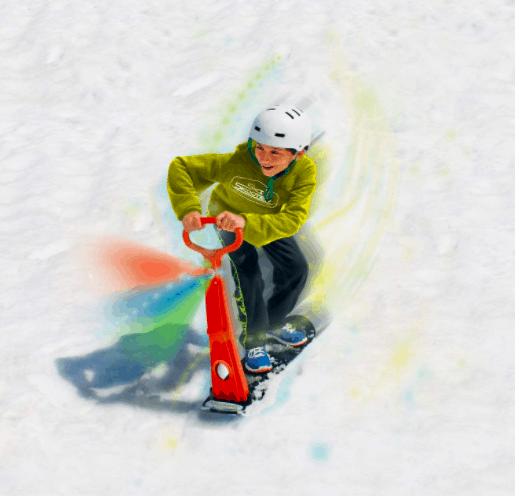 Boy Riding Down On A Snow Scooter Toy In Winter