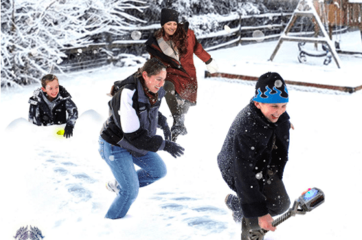 A Family Playing An Outdoor Winter Game Together.