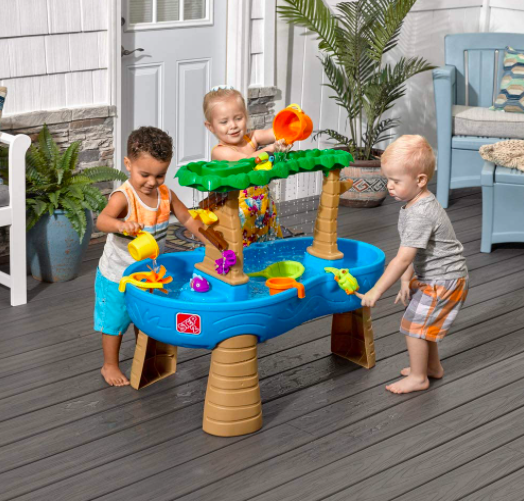 Three Children Playing With A Step2 Water Table For Kids. Step2 Makes Some of the Best Water Tables For Kids.