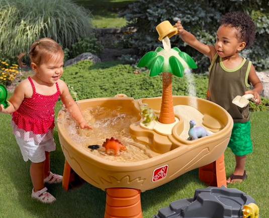 Two Children Playing With The Step2 Dino Dig Water Table For Kids. This Is One of the 11 Best Water Tables For Kids.