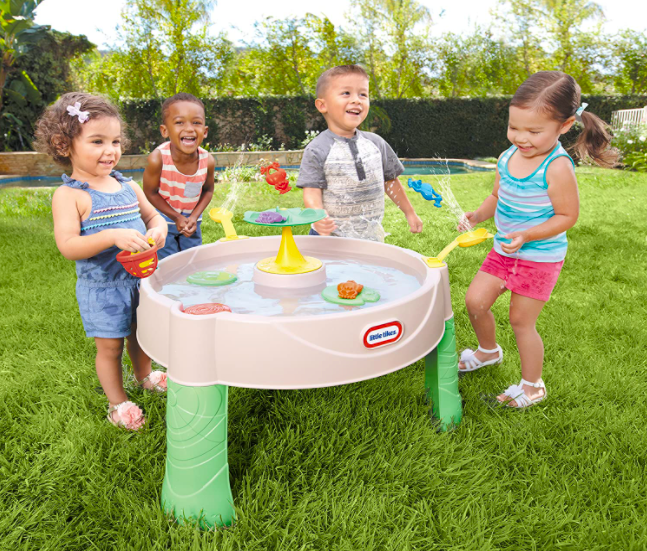 Four Kids Playing With The Little Tikes Frog Pond Water Table.