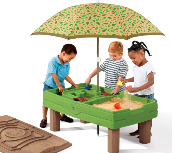 Three Kids Playing With A Water And Sand Table That Includes An Umbrella. One of the Best Water Tables For Kids.