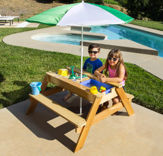 A 3-In-1 Water Table Option With Two Kids Playing. This Is A Model That Can Be Used As A Water Table, Sandbox, or Picnic Table.
