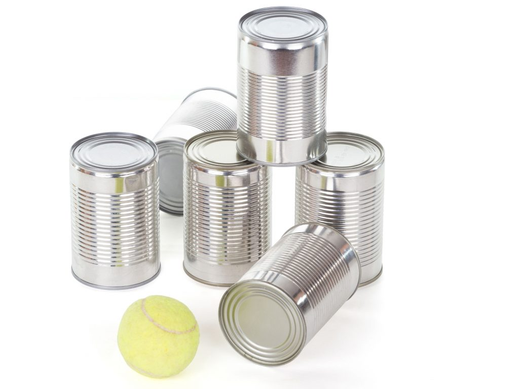 Soup cans and a tennis ball are all you need to create a can blaster game for your backyard.