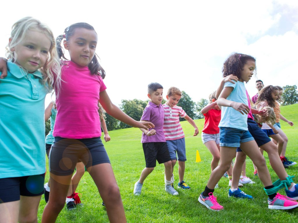 Children participating in the three-legged race.