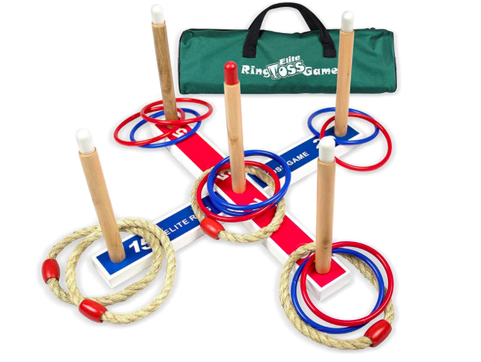 A ring toss game with five pegs and several rings for outdoor play even during winter.