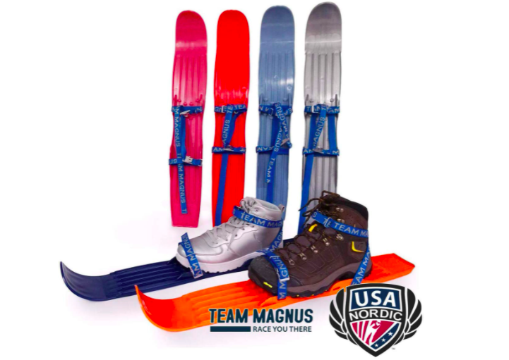 Four Skis Standing On End With Two Nordic Skis On The Ground With Snow Boots For Kids.
