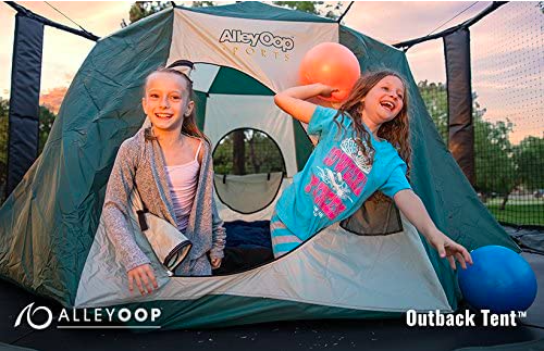 Two Girls Playing On A Trampoline With A Tent In The Middle.
