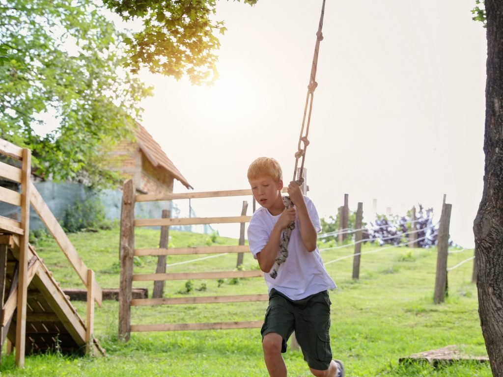 A Little Boy On A Rope Swing. You Can Also Attach A Rope Swing To Your Artificial Tree Limb.