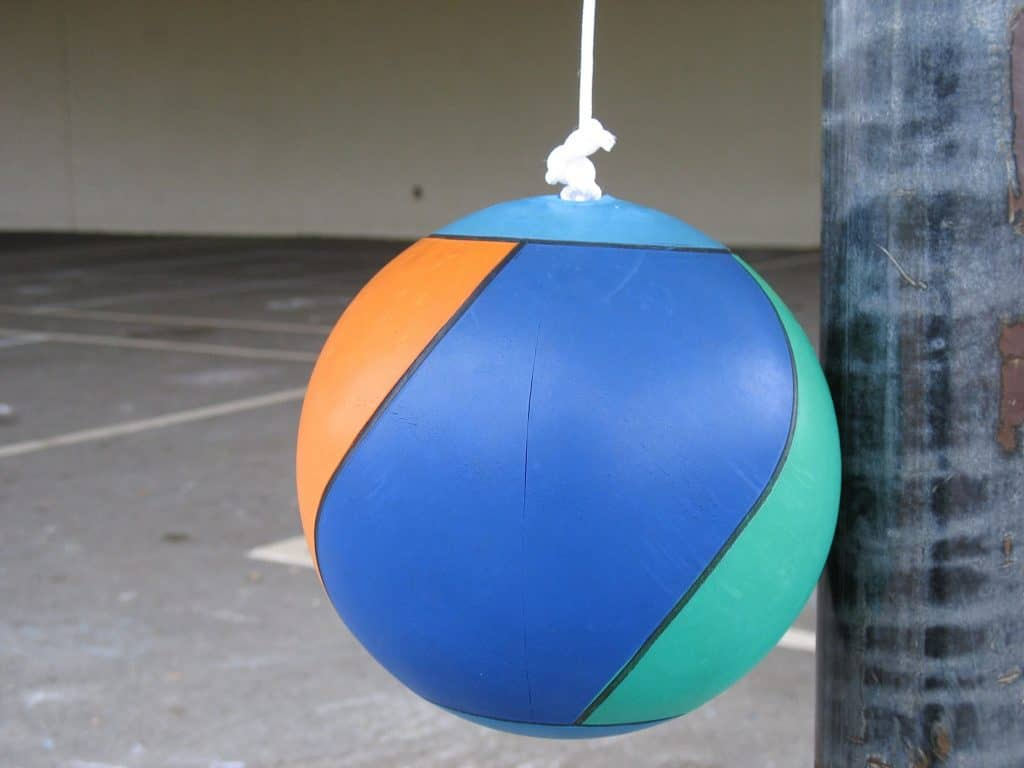 A Tetherball Hanging Next To A Tetherball Pole.