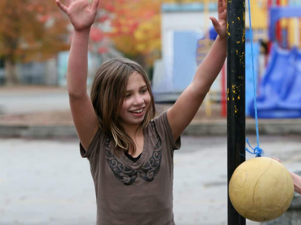 Young Girl Learning How To Play Tetherball.