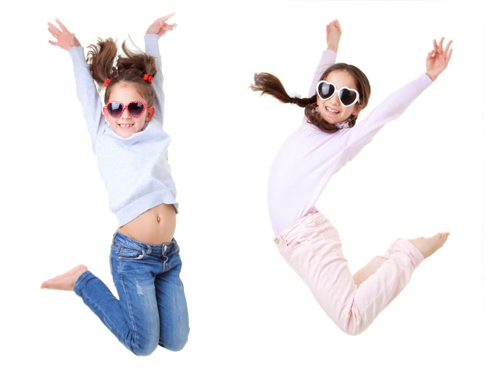 Two Girls Jumping In The Air During Simon Says.