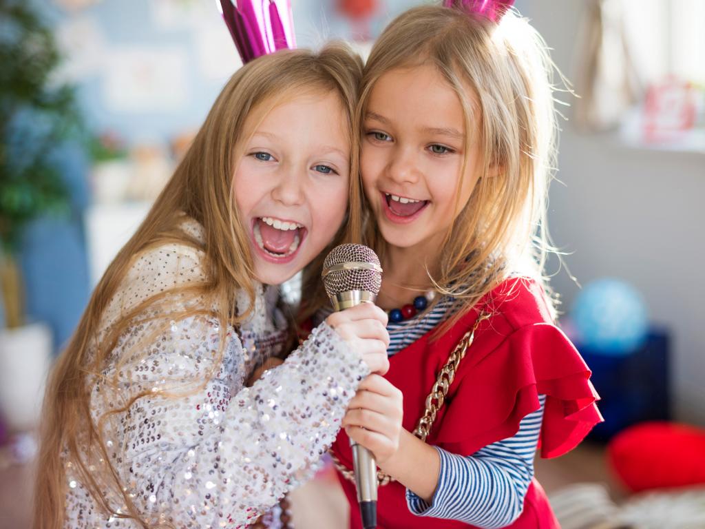 Two Girls Singing.