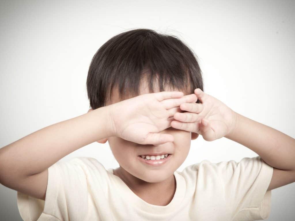 Little Boy Closing His Eyes As A Simon Says Idea.