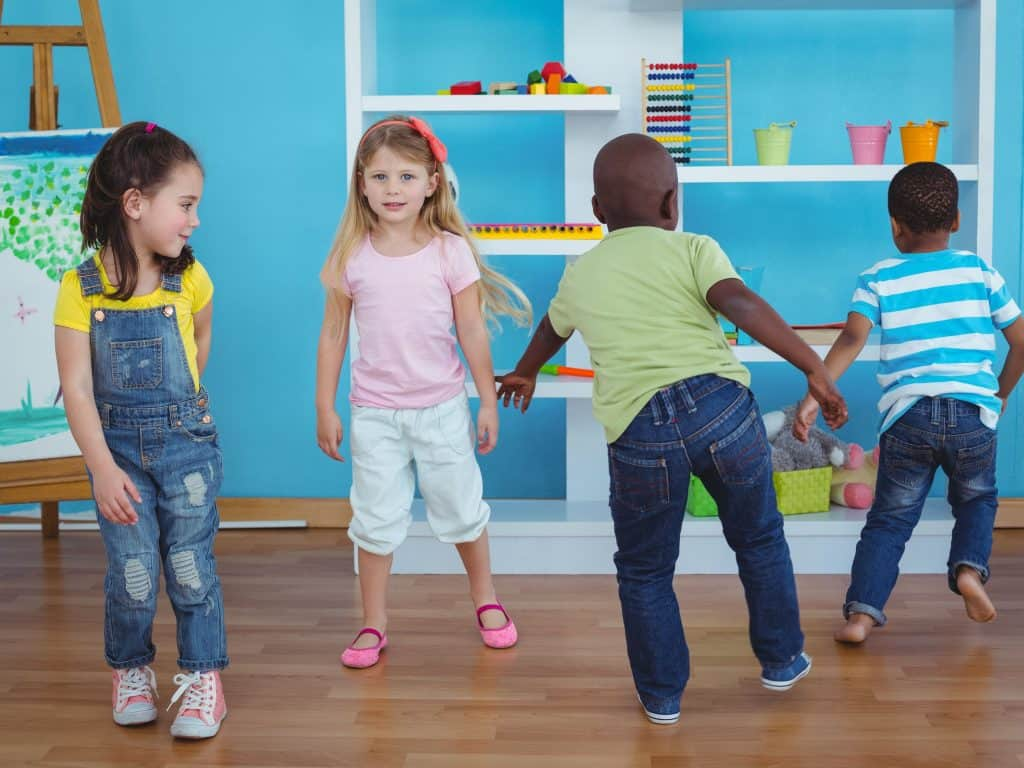 Little Kids Playing Simon Says.