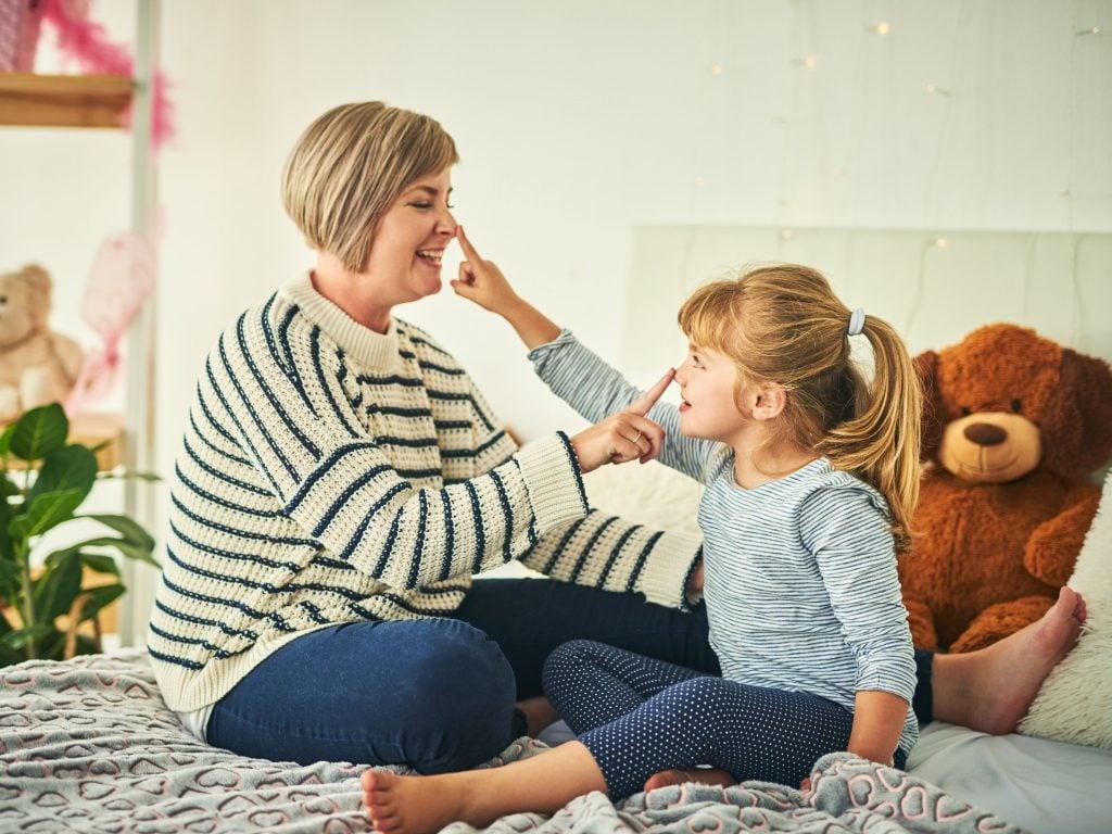 Mom and daughter play Simon Says game.